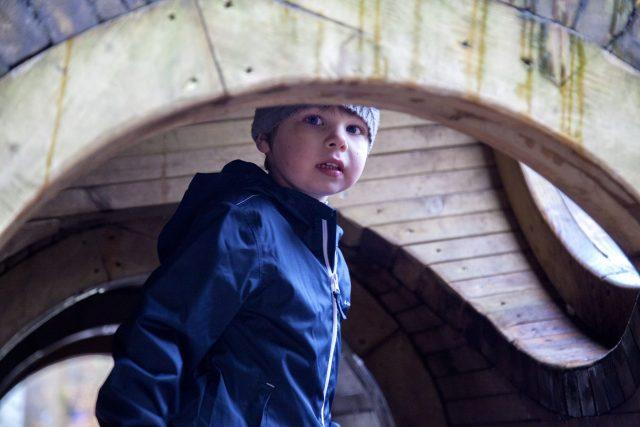 Exploring the giant wooden tunnel sculpture at Alice Holt Forest, Farnham, Surrey. For more, see https://lukeosaurusandme.co.uk