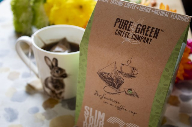 Pure Green Coffee Company packet with coffee brewing in the background. https://lukeosaurusandme.co.uk