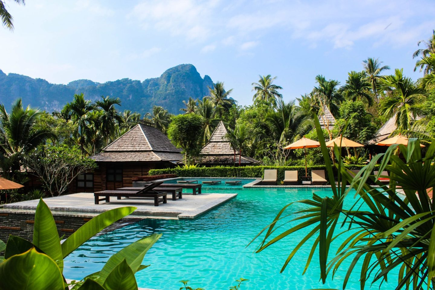 Luxury villa with walk ways and palm trees in Thailand