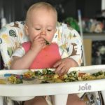 MummyToDex's baby sitting at a highchair eating food