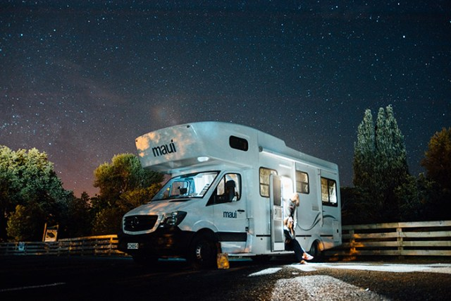 Motorhome with starry night sky behind for a blog post about campervan and motorhome holidays in the UK.