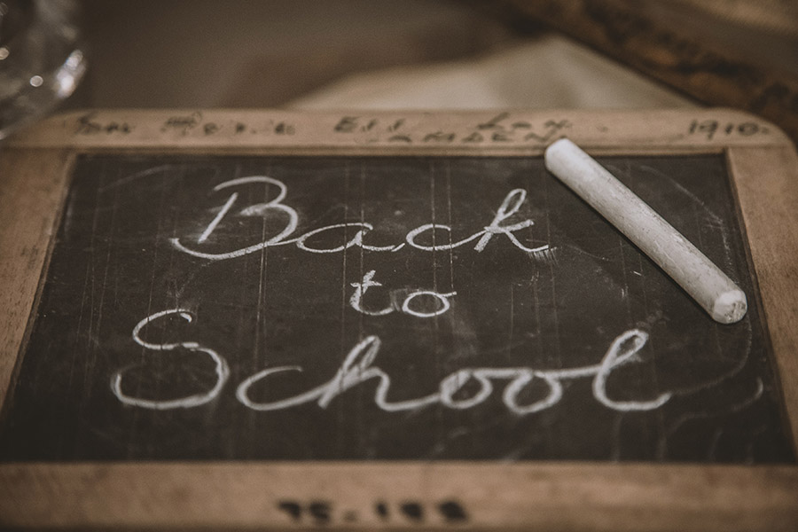 Chalk board with 'back to school' written on it for a blog post about going back to school after lockdown