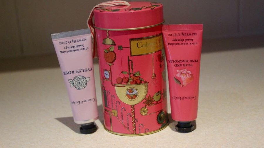 a small tin with two hand cream tubes inside.