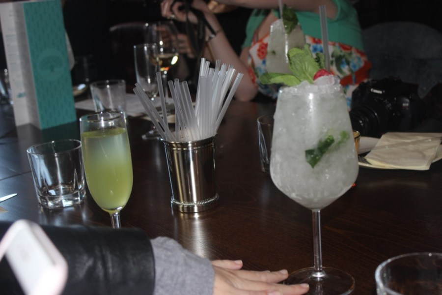 A picture of a Cucumber Cooler cocktail in a large glass.