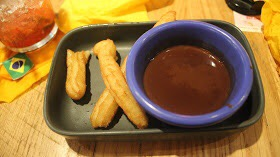 Some Churros and Chocolate Sauce.