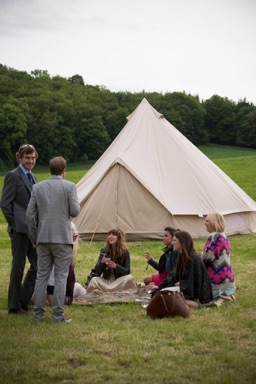 guests-sitting-on-grass-at-festival-themed-wedding