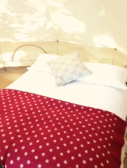 Bell-tent-interior-bed-cushion-blanket
