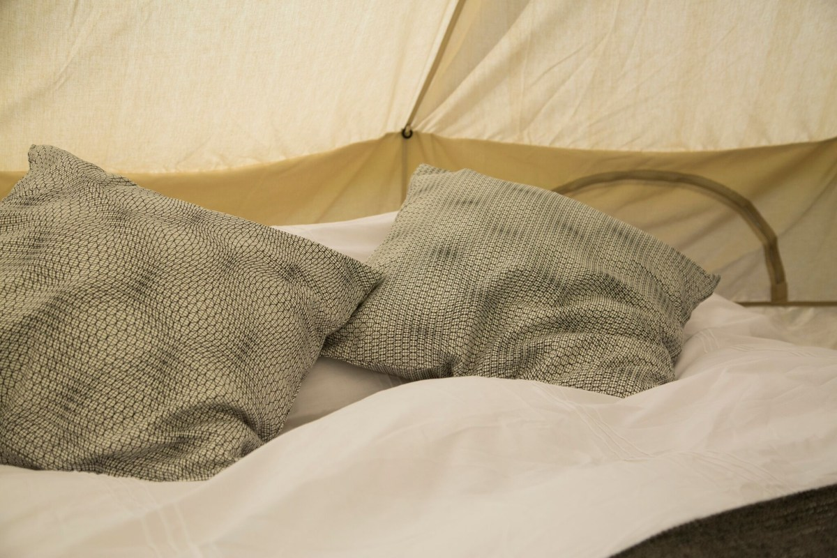 bedding-and-cushions-in-canvas-bell-tent