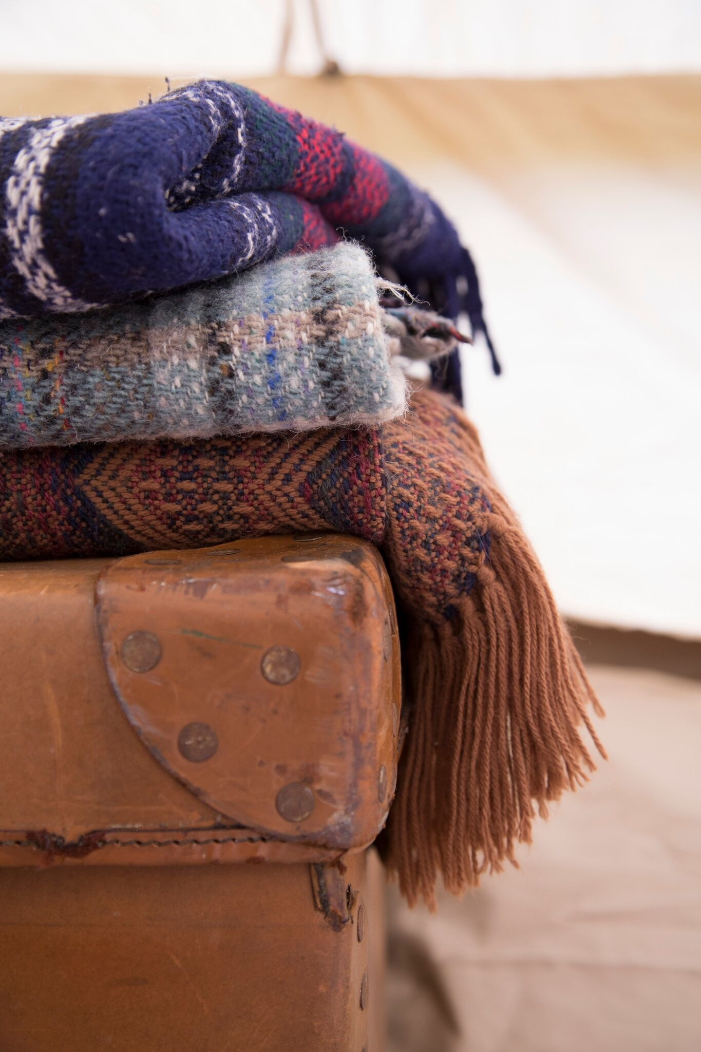 blankets-and-vintage-suitcase-in-a-bell-tent