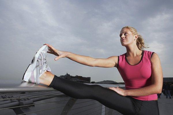 Woman stretching while wearing leggings