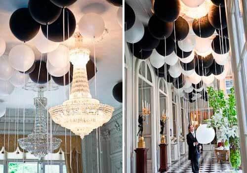 черные и белые шары в зале