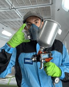 man in anti static spray paint suit by luma iii