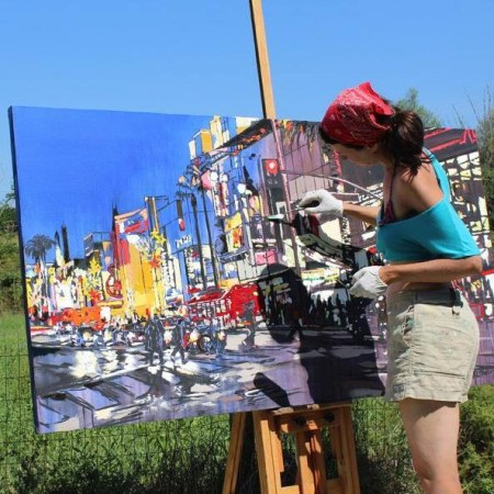Brooke Harker working on a painting of Hollywood, in Italy.