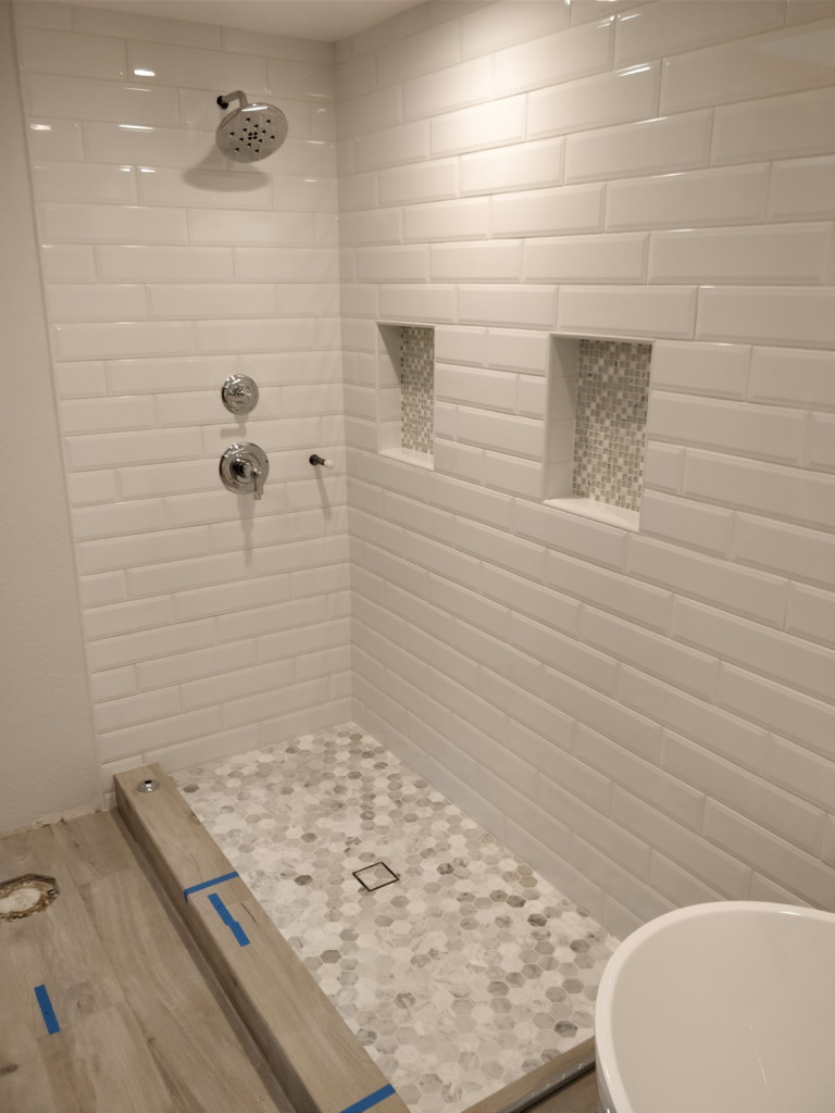 classic white subway tile shower with