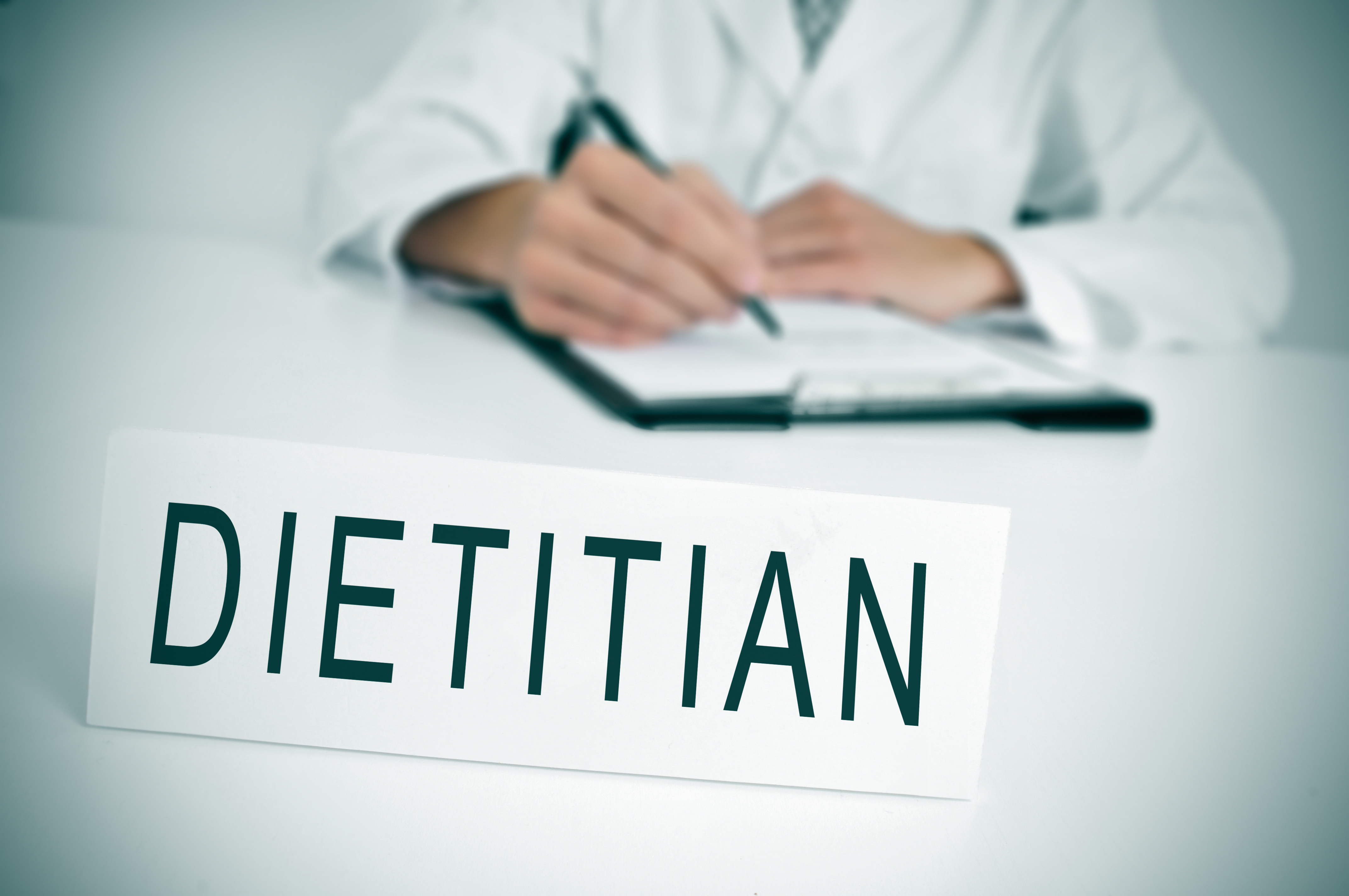 Dietitian sitting behind desk