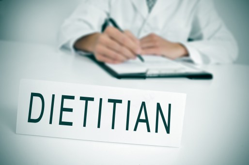 Dietitian sitting behind a desk during a consultation.