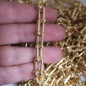 Cadena bañada en oro de 18k Eslabón U 15x7mm 1 metro LDB30118
