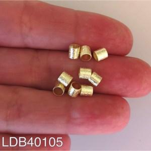 Mostacilla bañada en oro 1gr 9un aprox