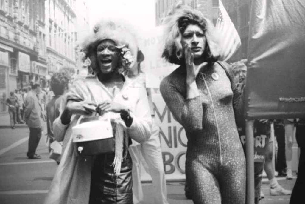 Black and white photo of Marsha P. Johnson and Sylvia Rivera marching in New York City in 1973