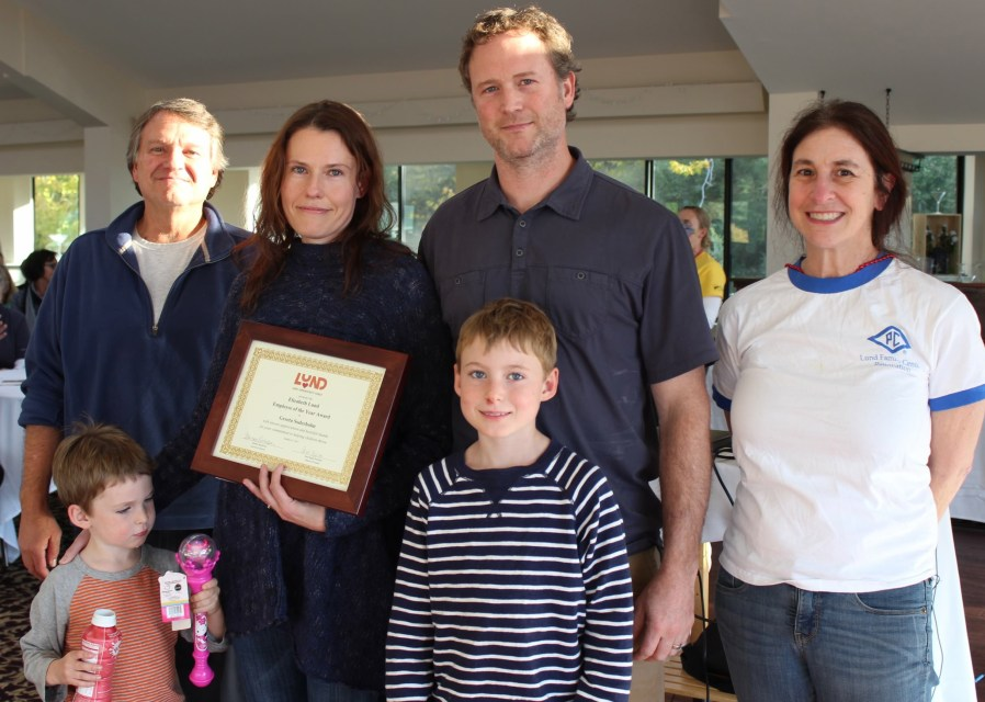 Greeta and her family with Brian Southworth (far left) and Barbara Rachelson, Executive Director of Lund (far right)