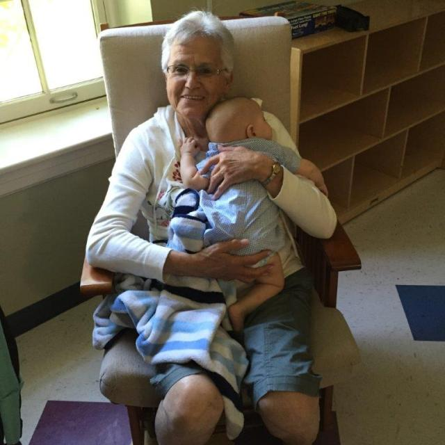 Laurette snuggles with one of our youngest residents this summer
