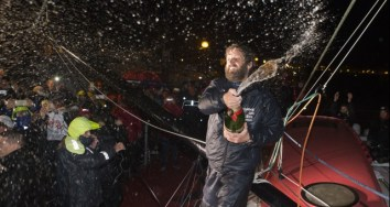 celebration-at-pontoon-with-mum-champagne-during-finish-arrival-of-eric-bellion-fra-skipper-comme-un-seul-homme-9th-of-the-sailing-circumnavigation-solo-race-vendee-globe-in-les-sables-d-olonne-france