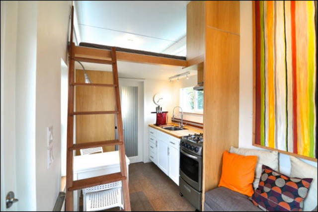 Tiny house rental in portland oregon with full bed couch kitchen and complete bathroom.