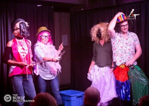 Four people on stage at The Albany Great Portland Street in Fancy Dress
