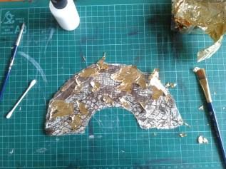 Dot gilding glue on print and apply gold leaf