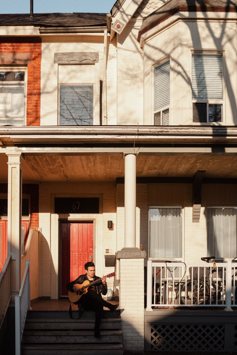 Peter Serrado in front of house in Kensington Market