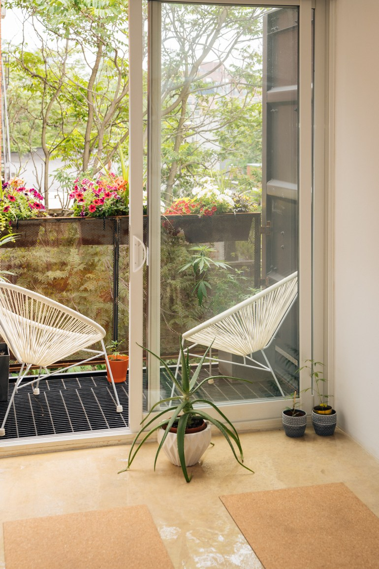 Shipping container home - balcony with chairs