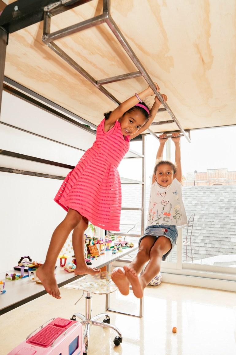 children swinging from monkey bars