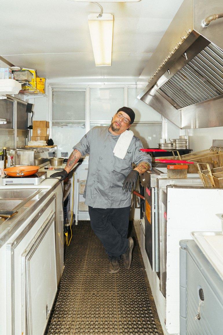 Danny Raposo standing in food truck