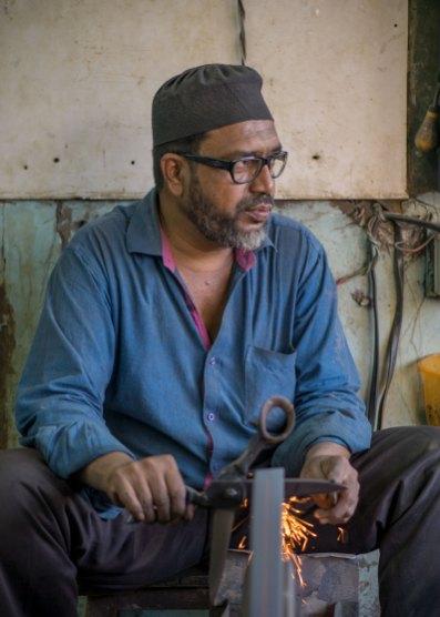 Man sharpening scissors in Mumbai
