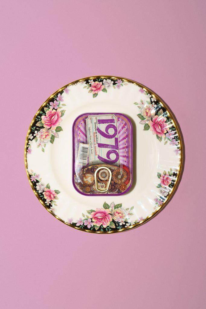 Comur sardine can on a plate