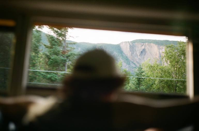 man in car in Quebec mountains
