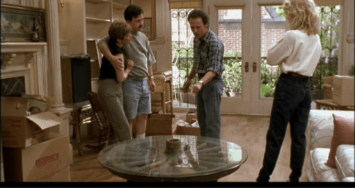 Billy Crystal (Harry) gives Marie and Jess his verdict on the wagon-wheel table.
