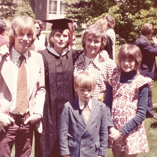 Doug, in front, looking really thrilled about attending my college graduation. (That's Roger on the left, and Laura on the right)