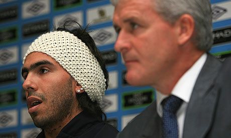 Carlos in a haf-finished knitted hat