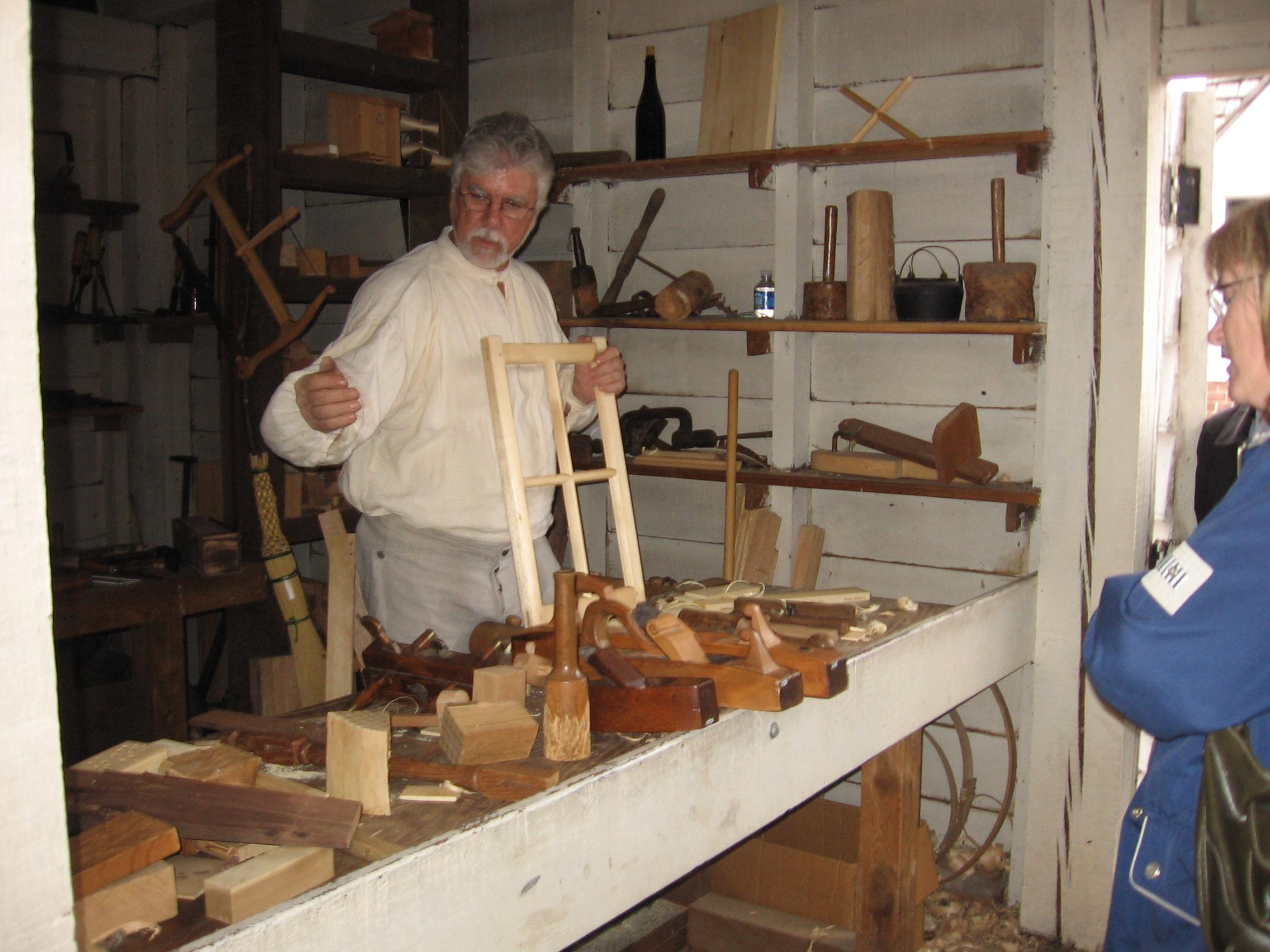 volunteer demonstrates woodworking