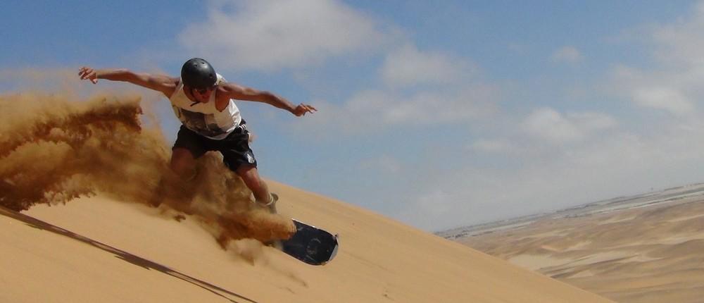 Sand boarding in Namibia