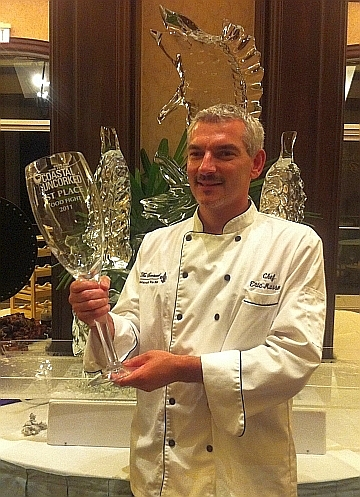 Chef Masson with trophy for 1st place Coastal Uncorked Iron Chef Competition (Photo courtesy of Brentwood)