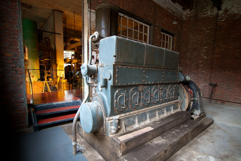 A third electrical generator sits across from the original steam powered equipment