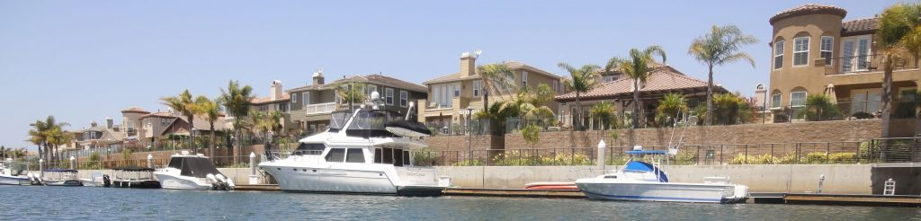 Gondola in Channel Islands Harbor, Oxnard, Ca., tours the homes and boats on the canals. Photo by Allan Kissam