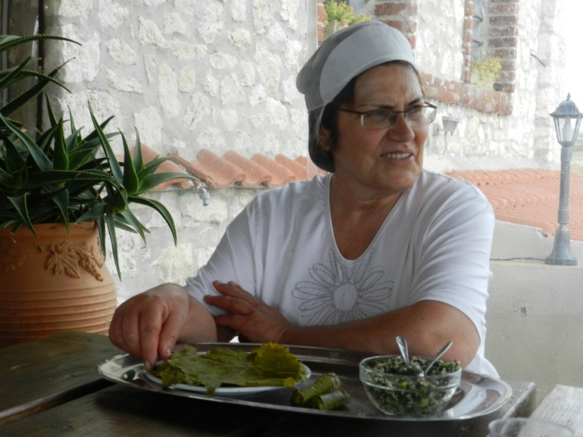 Marianna demonstrating rolling grape leaves