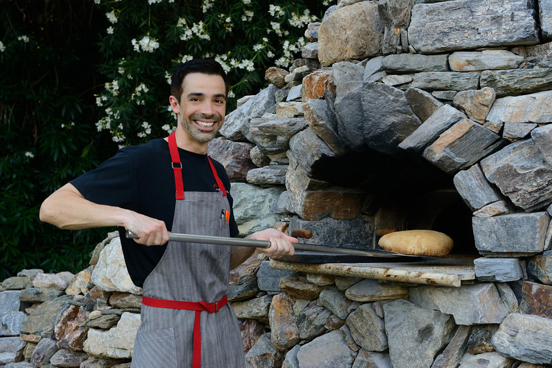 Stone oven in stone courtyard courtesy of The Farm at South Mountain