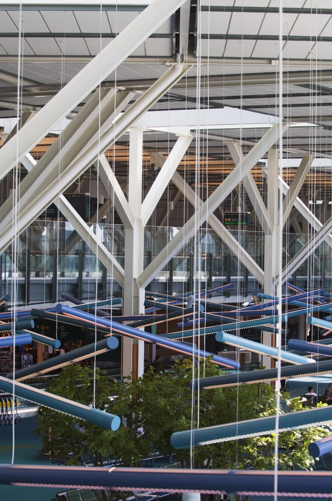 The linear lighting in the International Terminal depicts the log jams once ever present on the Fraser River. Photo by Vancouver Airport Authority