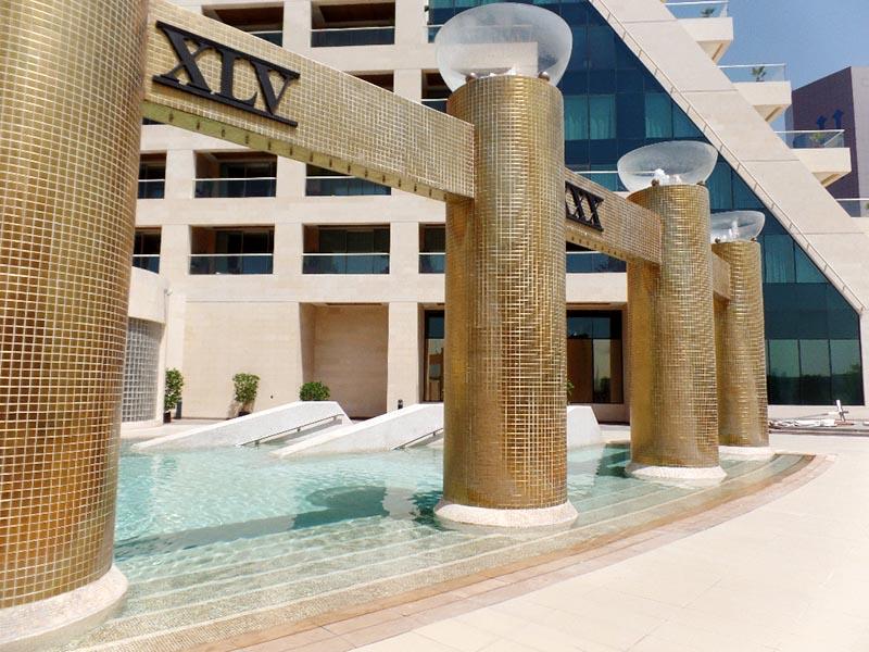 The Raffles Pool Golden Columns