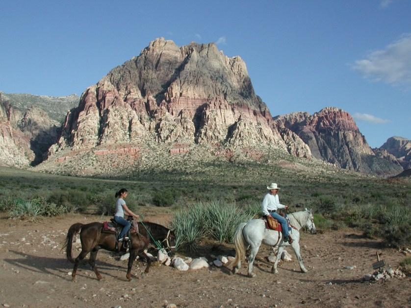 Horseback riding amid some spectacular mountain and desert scenery