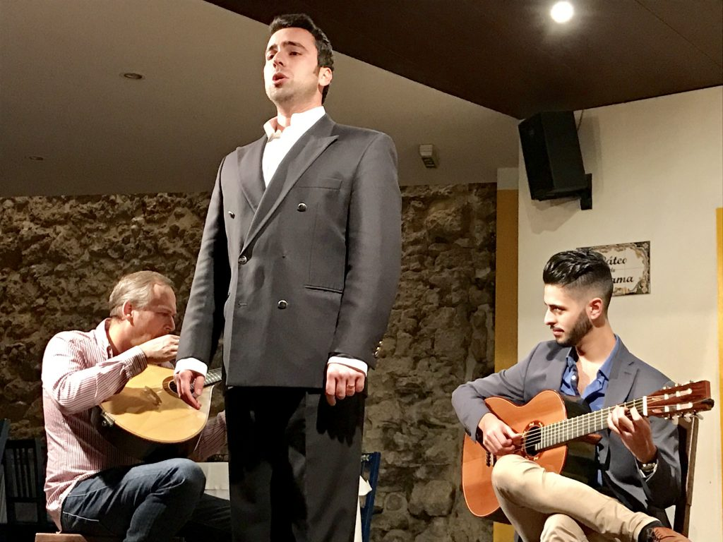 Fado, the traditional songs of longing accompanied by guitar.